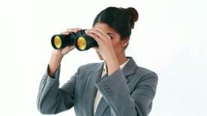 stock-footage-happy-businesswoman-looking-through-binoculars-against-a-white-background