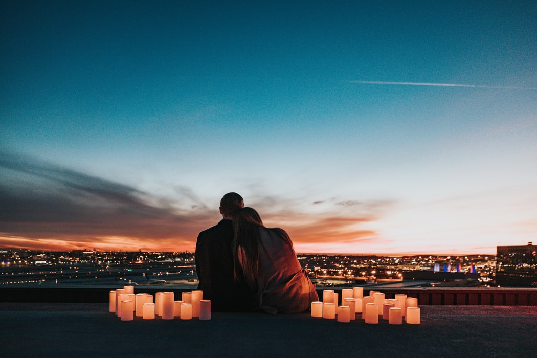 A couple is watching evening city