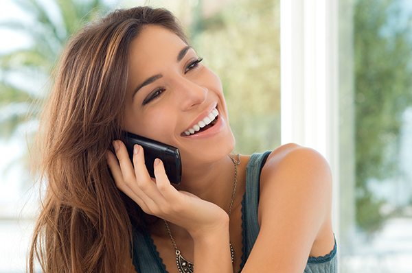 Lady talking over the phone and smiling